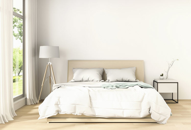 vista de un dormitorio todavía sin hacer la cama